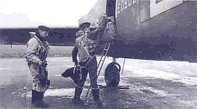 Ian Nicolson loads up his gear for the next mission on a Lancaster